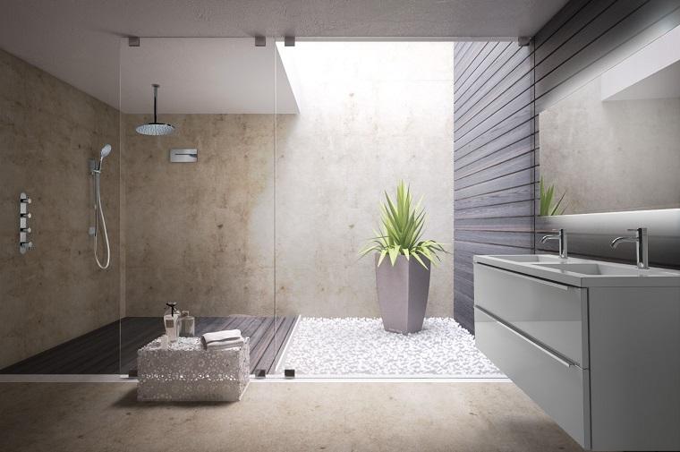 Come arredare un bagno con cabina doccia e soffione rotondo sospeso dal soffitto