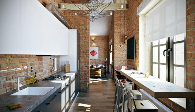 stanza stretta e lunga con mobili della cucina lineare e tavolo con sgabelli e interni in pietra