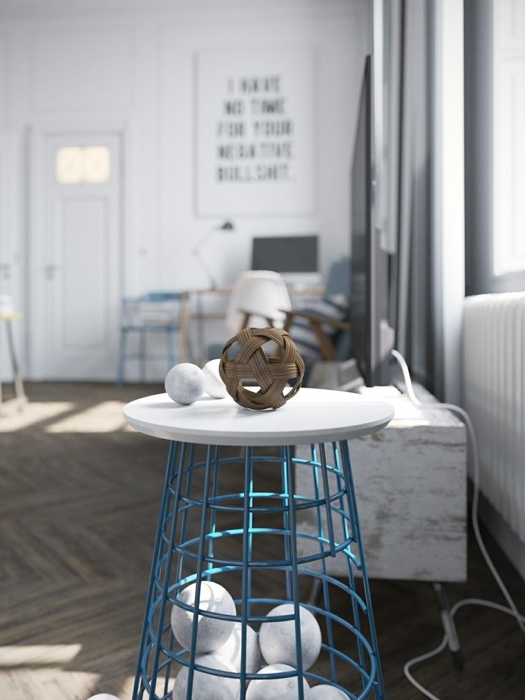 Decorare il soggiorno con un tavolino di metallo e palline artistiche di vario materiale
