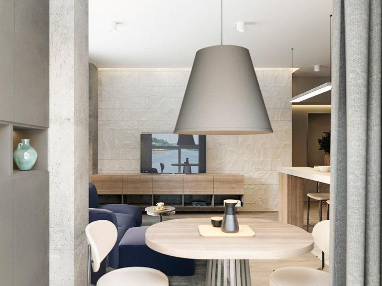 Lampadari moderni soggiorno insieme ad una sala da pranzo arredata con tavolo di legno e due sedie