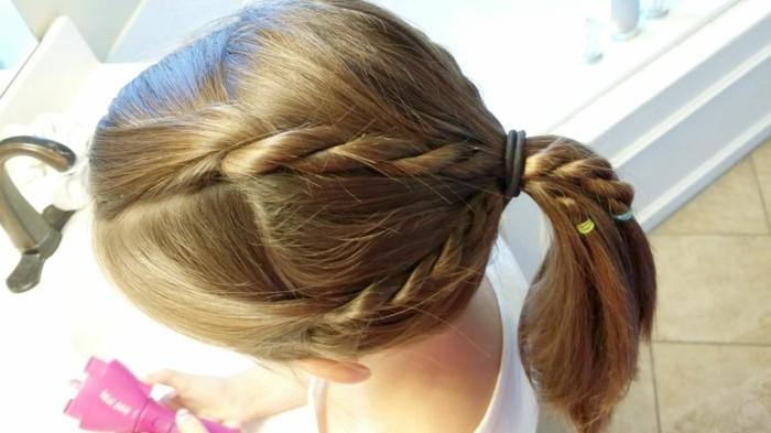 idea per acconciature capelli lunghi facili con delle trecce raccolte in una coda