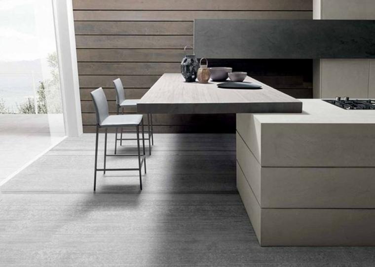 idea per arredare una cucina con penisola adibita a tavolo con due sgabelli dal design moderno
