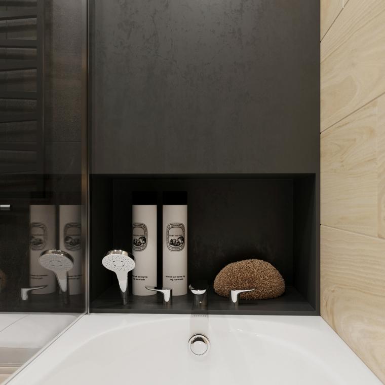 Come arredare un bagno con vasca e nicchia in cui disporre gli accessori