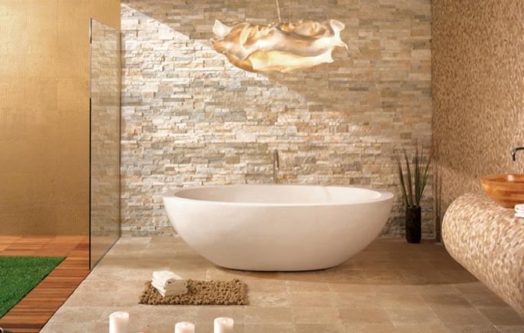 rustico e moderno bagno con vasca ovale freestanding e parate in muratura