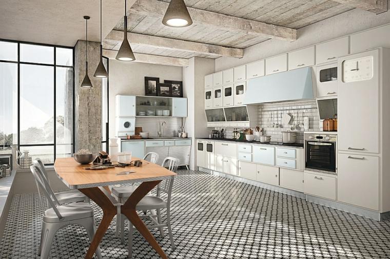 luminosa e ampia cucina bianca open space con tavolo con top in legno, muri in pietra per interni