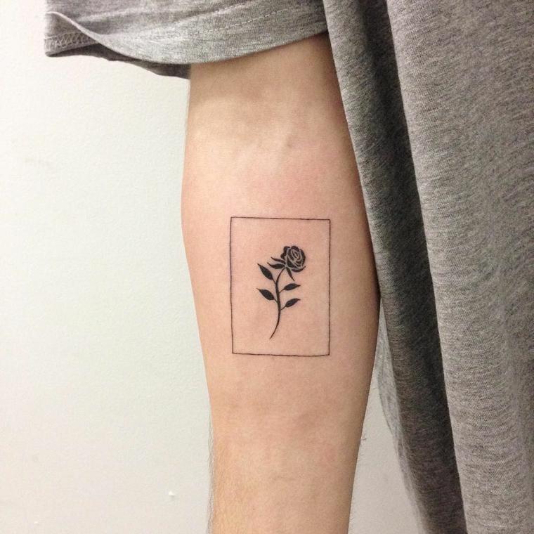 deliziosa rosa stilizzata nera all'interno di un rettangolo, idea per un tattoo avambraccio