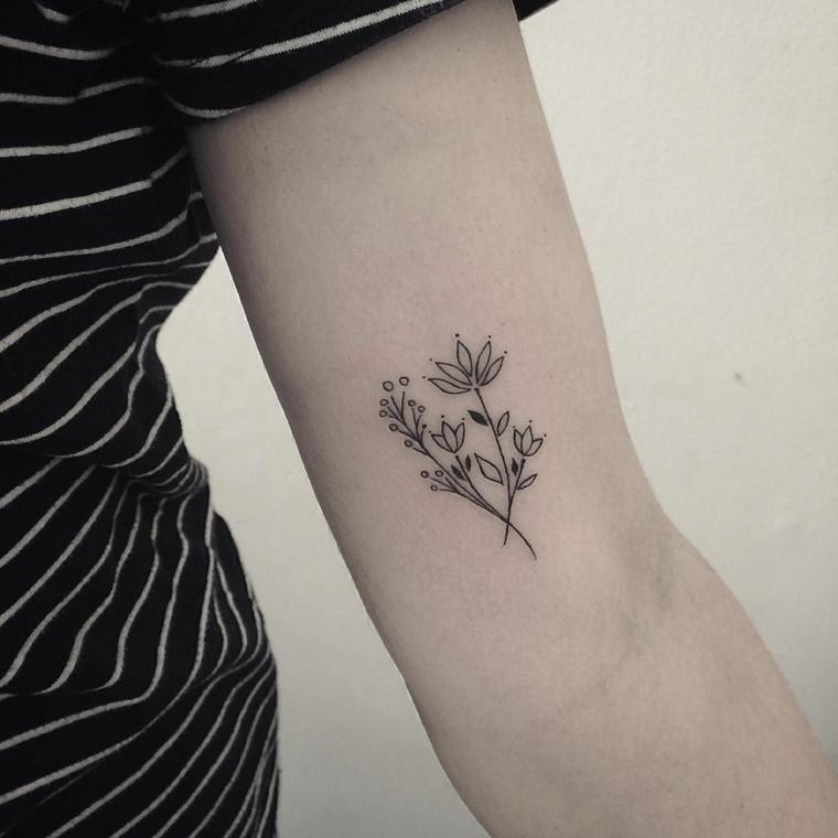 esempio per tatuaggi eleganti adatti ad un pubblico femminile, dei fiori con rami stilizzati
