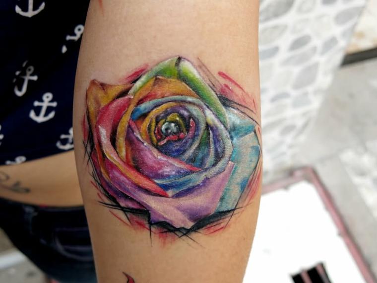 bellissima rosa con i petali tutti colorati, idea per un tattoo femminile sul braccio