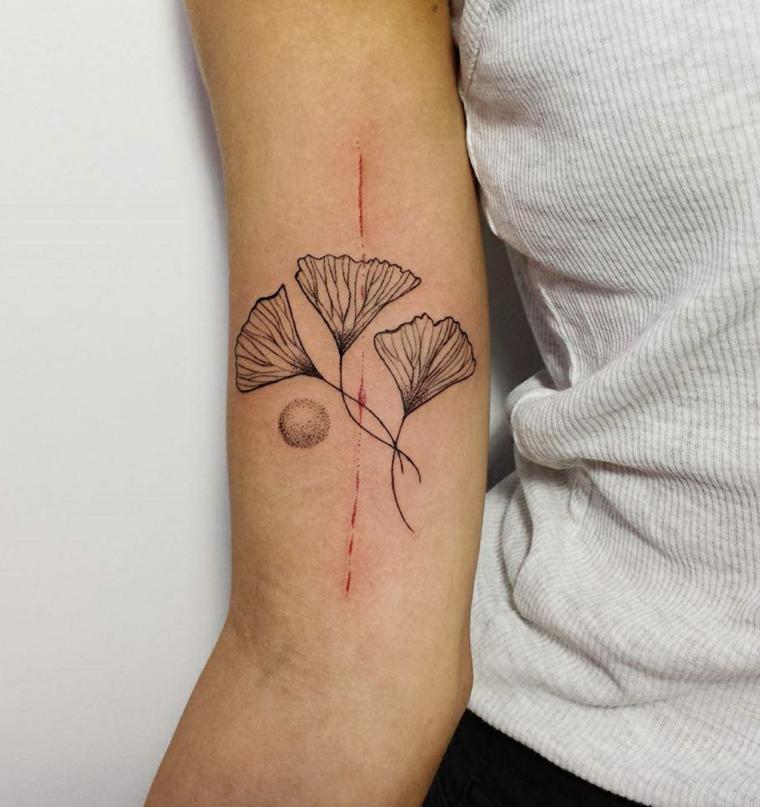 Idea per dei tatuaggi avambraccio un tatto con fiori una linea di colore rosso