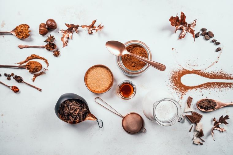 Come fare una cioccolata calda, ingredienti in ciotole, barattolo di vetro con cacao