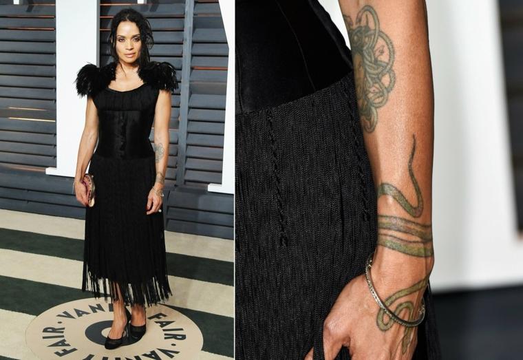 Un'idea per tatuaggio braccio di Lisa Bonet con un serpente bracciale e mandala sull'avambraccio