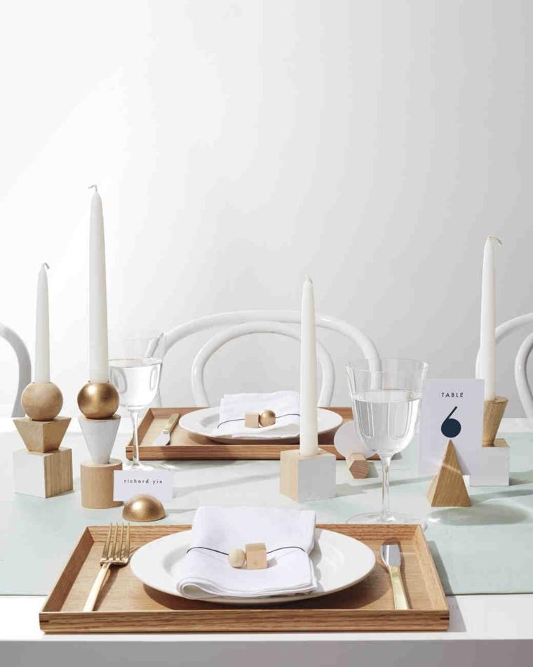 Candele segnaposto per un tavolo da matrimonio decorato in stile nordico