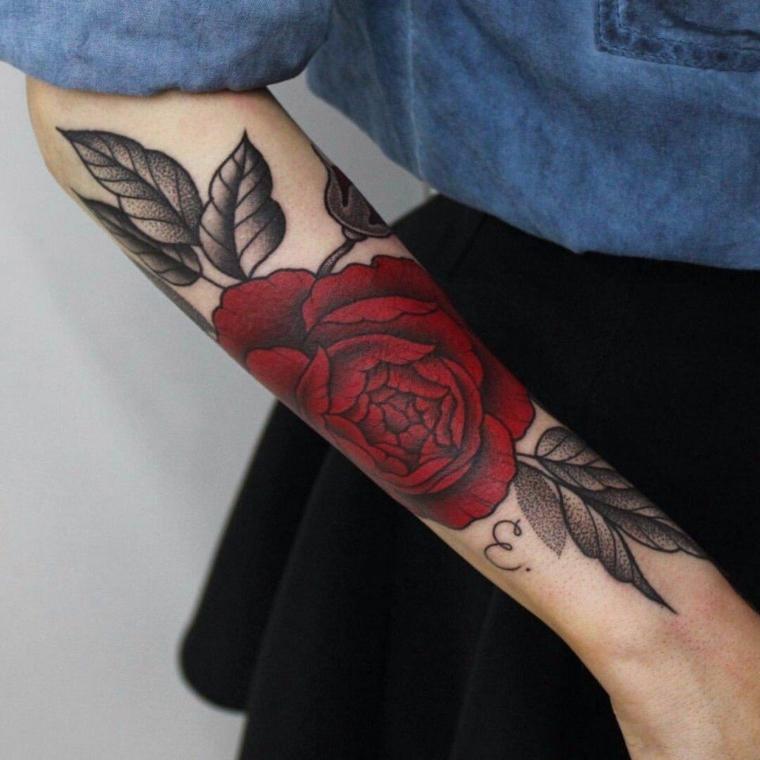 Tattoo scritte braccio e un'idea per tattoo rosa di colore rosa con fogli nere