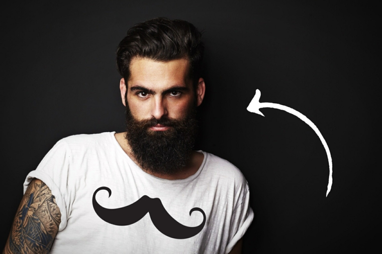 Ragazzo con tatuaggi sul braccio e barba nera e lunga con baffi