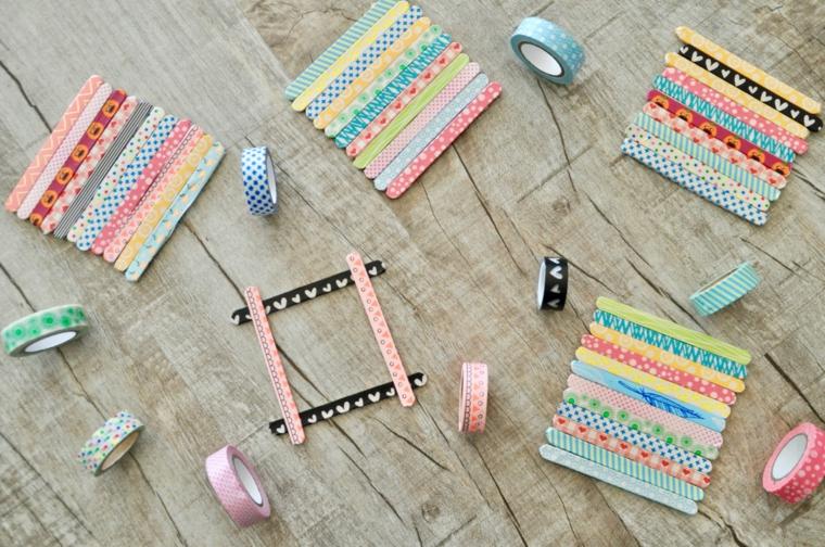 Cornici foto fai da te da stecchini di legno e decorati con del nastro washi tape