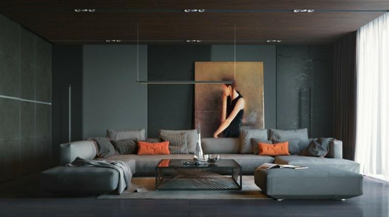 Mobili soggiorno moderni nella tonalità di colore nero con un divano a C e tavolino di vetro