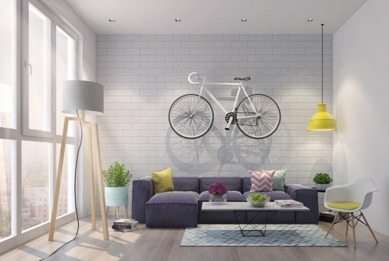 Soggiorni moderni componibili e un'idea di arredamento con un divano imbottito e lampada sospesa di colore giallo