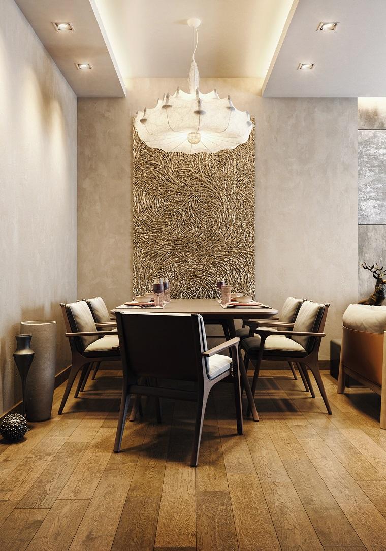 Saloni moderni con un divano imbottito e sala da pranzo con tavolo apparecchiato e sedie