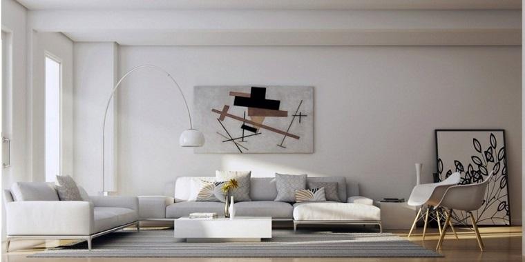Soggiorni componibili e un'idea di arredamento con divano imbottito grigio e tavolino bianco laccato