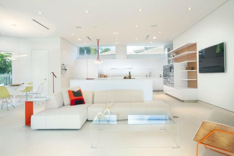 Salotti moderni e un'idea di arredamento con divano ad angolo di colore bianco in pelle e tavolino di vetro trasparente