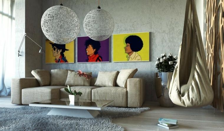 Soggiorni componibili e un'arredamento moderno con divano imbottito di colore grigio e tavolino con superficie di vetro