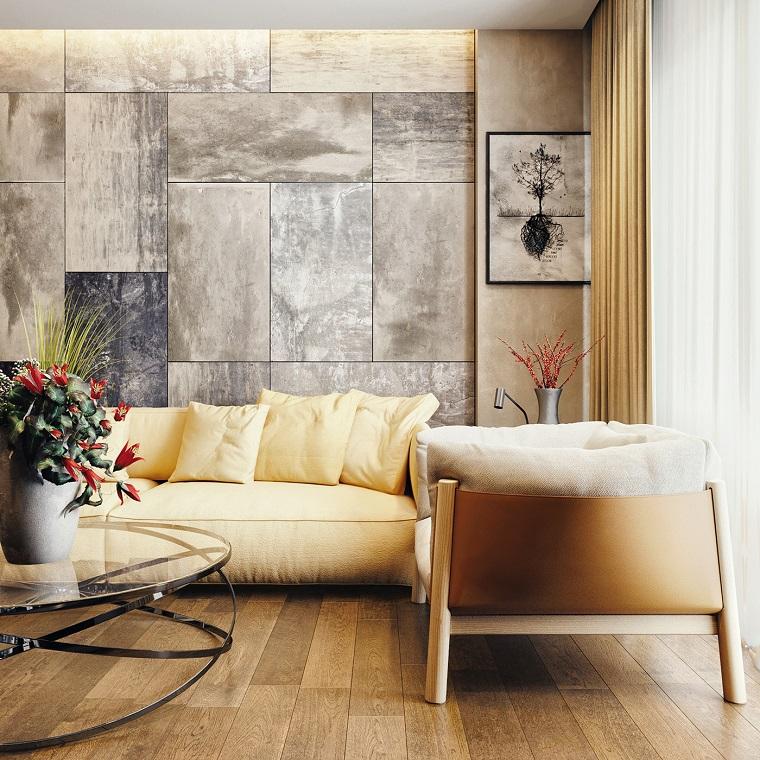 Mobili soggiorno moderni con un tavolino rotondo di vetro e divano giallo