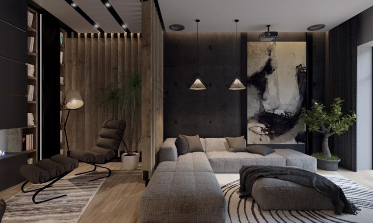 Parete attrezzata con camino e una sedia imbottita, soggiorno con divano angolare di colore grigio