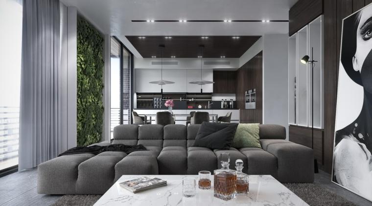 Divano nero imbottito con tavolino di marmo e una cucina a vista bianco e nera