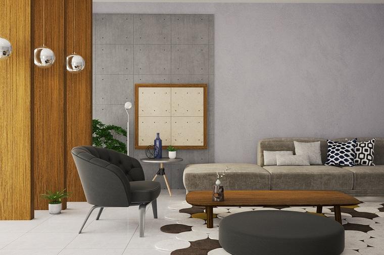 Pareti colorate soggiorno nelle tonalità del grigio, arredamento con un divano, poltrona nera e tavolino di legno