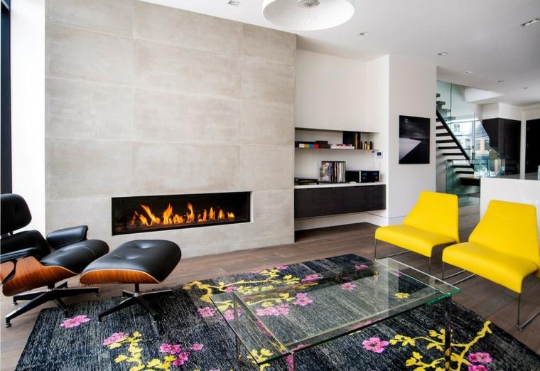 Esempi arredamento soggiorno e una proposta con camino moderno su una parete