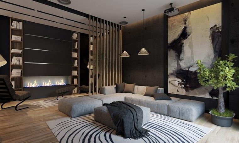 Salotti moderni e un'idea di arredamento con un divano imbottito di colore grigio e camino moderno