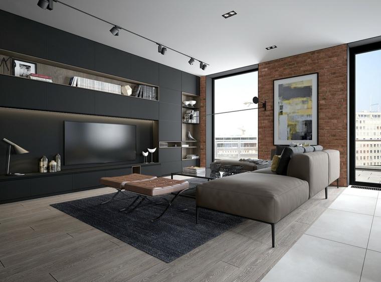 Soggiorno arredato con un divano grigio di pelle e parete nera con nicchie di cartongesso
