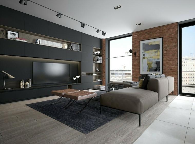 Saloni moderni e un'idea di arredamento con parete in cartongesso di colore nero con nicchie e divano grigio di pelle
