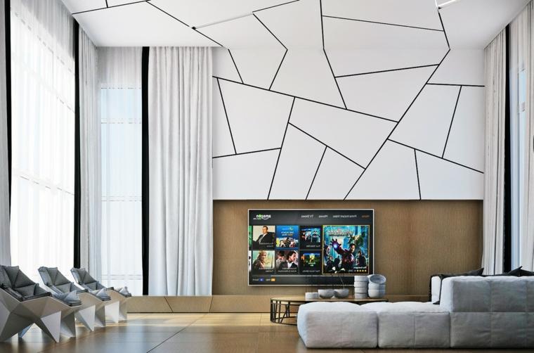 Soggiorno moderno con parete e soffitto bianco forme geometriche, dicano imbottito e tre poltrone con cuscineria di colore grigio