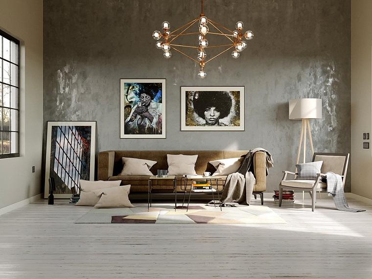 Soggiorni moderni componibili e un'idea con lampadario di rame sospeso e tappeto forme geometriche