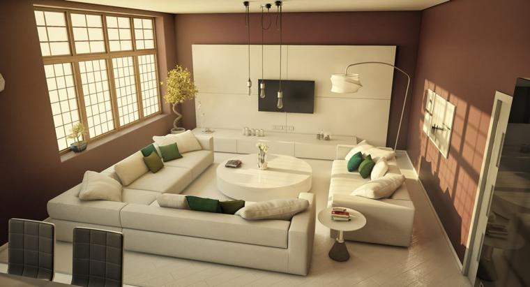 Soggiorni componibili e una proposta con divano ad angolo di pelle con tavolino rotondo