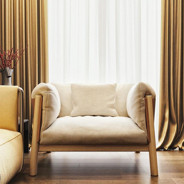Idea di arredamento con una poltrona di colore beige per dei salotti moderni con pavimento in legno