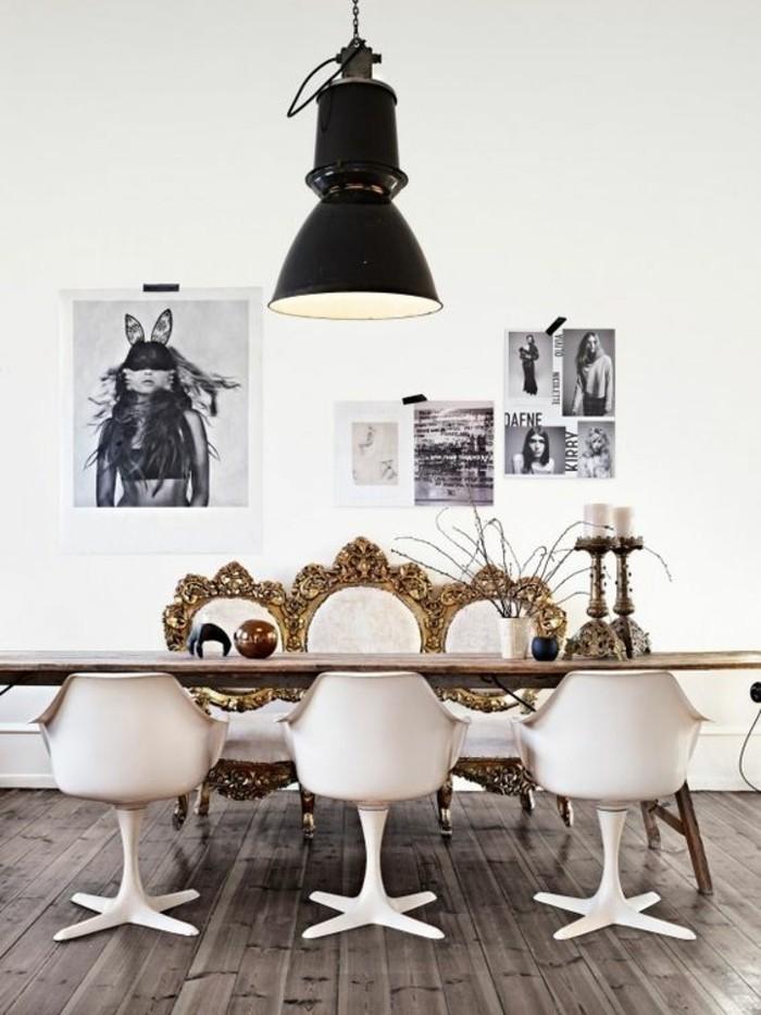 Mobili salotto moderni con un tavolo di legno molto lungo e sedie bianche di design