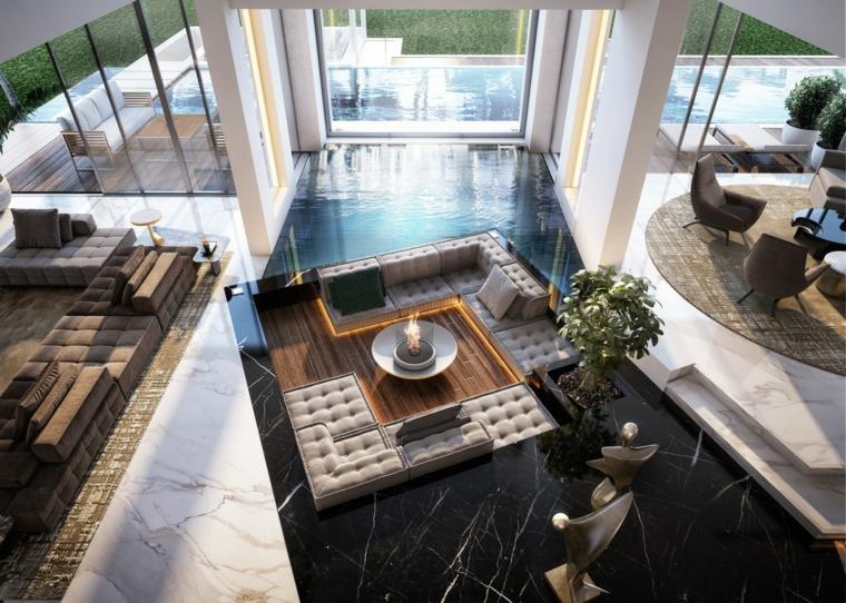 Salotti moderni e un'idea di arredamento con un camino al centro con divani imbottiti di colore beige