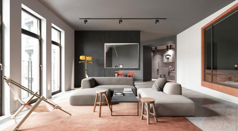 Arredamento moderno per un soggiorno con parete nera e divani grigio imbottiti