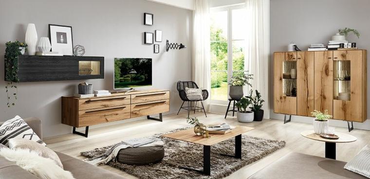 Arredamento soggiorno con mobili di legno con base di metallo, decorazioni da parete con quadri