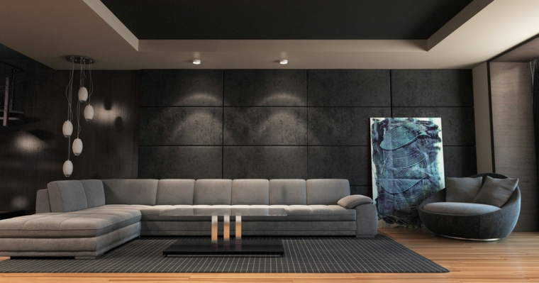 Soggiorno moderno con un divano con isola di colore grigio e tavolino di vetro