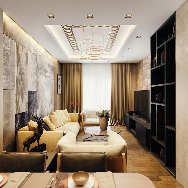 Arredare salotto e sala da pranzo insieme con mobili di legno e pareti con pannelli colorati