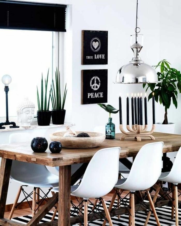 Idee pittura pareti soggiorno di colore bianco e decorate con quadri