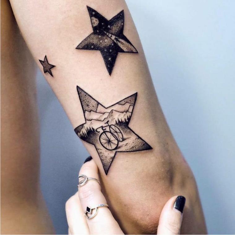 Stelline tattoo braccio uomo dalle dimensioni grandi con disegni all'interno