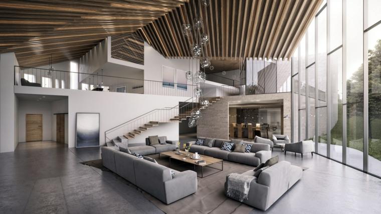 Saloni moderni con e un'idea con quattro divani grigi e tavolino di legno al centro del soggiorno