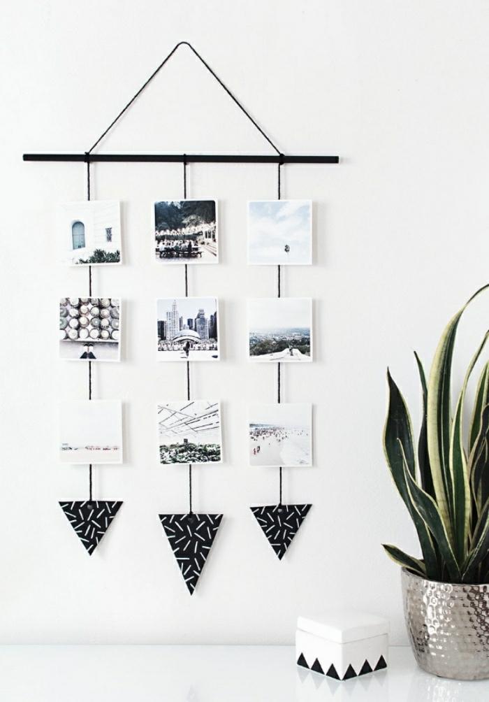 Idee lavoro fai da te con un portafoto di legno con fotografie sospese su dei fili