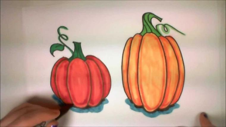 Lavoretti per bambini con disegni di zucche da colorare su un foglio bianco