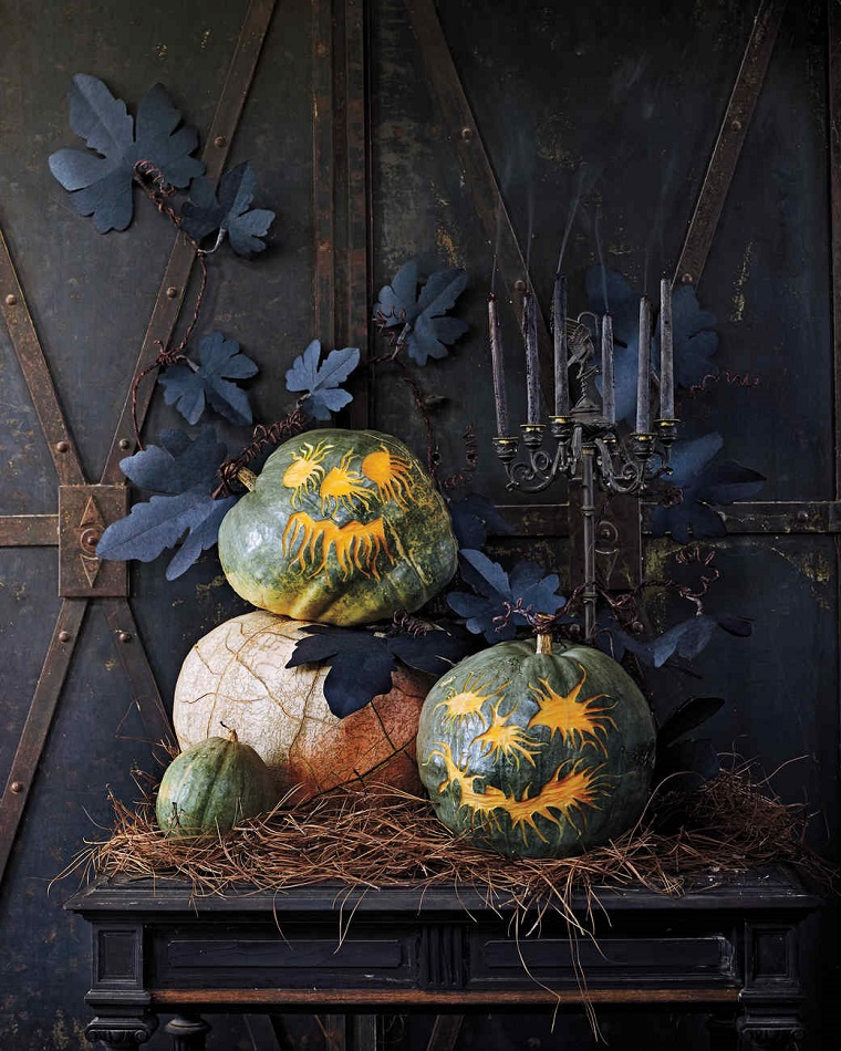 Come intagliare una zucca, decorazione per Halloween una ghirlanda di foglie di carta nera