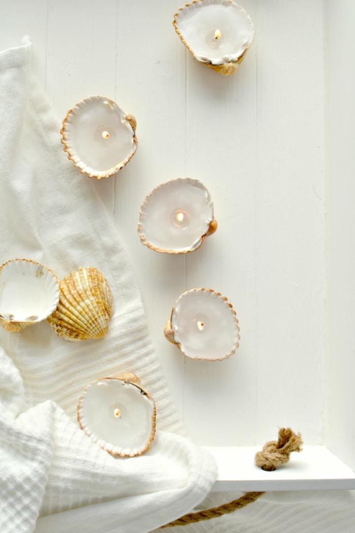 Lavori artigianali, conchiglie trasformare in candele con cera e stoppini